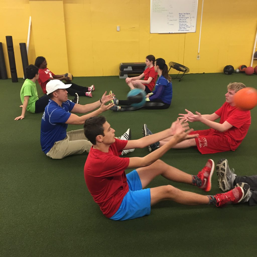 Medicine ball toss at the gym